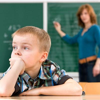 kid-looking-away-from-blackboard